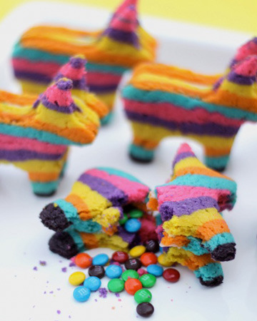 thecakebar:  Pinata Cookies Tutorial {click link for more pics and full tutorial} Yesssss it's a mexican pinata cookie!  There is real candy hiding in these colorful cookies just like a real pinata?! This might work for Saint Patricks day too because of the rainbow colors! :s