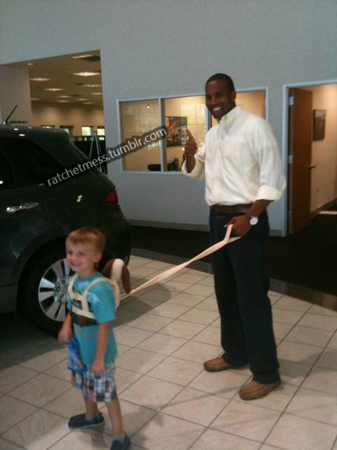 Just what a black man needs: a white child on a leash, also known as an on the spot ass whipping from police