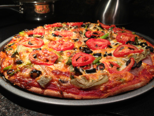 reblogged from wakeupalexis:  Holy fucking crap look at the vegan pizza my grandma and I just fucking hand made. Gah it was so good, basically a salad on top of the pizza because the toppings were: -tomatoes -olives -artichoke hearts -asparagus -red onion -mushrooms -vegan mozzarella/jack cheese blend. I love cooking so much. Sheesh.
