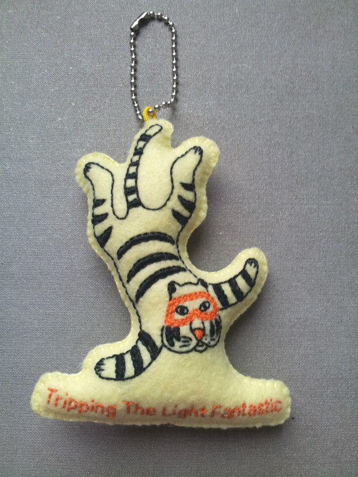 "The Quirky Girl Crafter made a one off felt keyring based on the tiger from the Tripping The Light Fantastic 7"" cover that I designed.I think it looks pretty cute! The singel is coming out early April on Cloudberry Records, I'll tell you more and post some pictures of it then!"