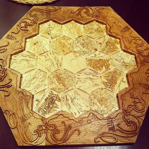 Woodcarved Settlers of Catan board.   #catan #settlersofcatan #design #art  By: Milestone Manufactory