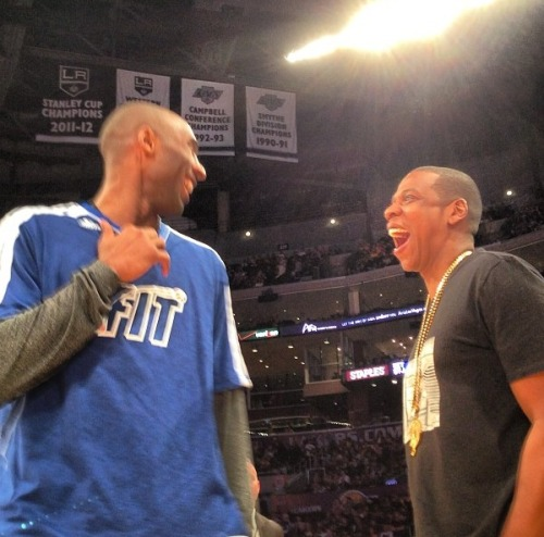 Kobe Bryant and Jay-Z sharing a laugh before today's Lakers victory over the Oklahoma City Thunder