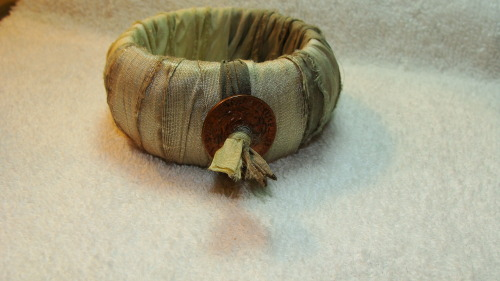 eclecticfaith:  silk wrapped - wood bangles - upcycled - neutral colors - earth tones - boho -boheme - grey - cream - old coin - vintage coin http://www.etsy.com/shop/madhattresscreations