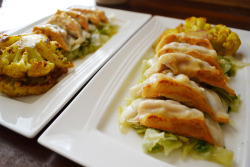 pot stickers served with curry cauliflower florets on a bed of lettuce.
