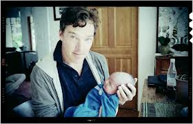Benedict touching an infant.