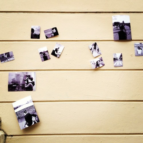 Black and white photos, posted on a wall in Montmartre. Real-life facebook?