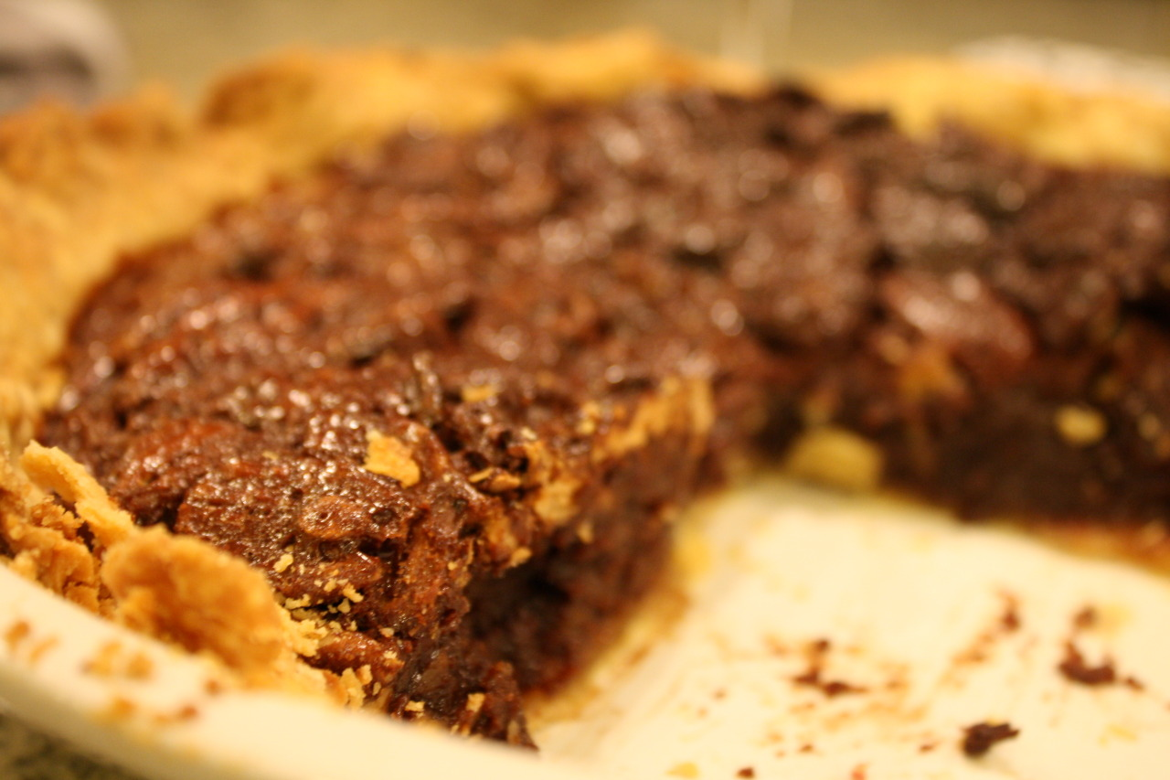 Fudgey Pecan Pie Ingredients: 1/3 cup butter 2/3 cup sugar 1/3 cup cocoa 3 eggs I cup light corn syrup 1/4 tsp. salt 2+ cups pecans 1 pie crust (I use the basic Martha Stewart recipe)  Directions: Heat oven to 375. In a medium saucepan over low heat, melt the butter. Add sugar and cocoa, stirring until well blended. Remove from heat and set aside. In a medium bowl, beat eggs slightly- stir in corn syrup and salt. Add cocoa mixture; blend well. Stir in pecans (add more if you'd like). Pour into unbaked pie shell. Bake at 375 for 50-60 minutes, or until knife inserted in center comes out clean.