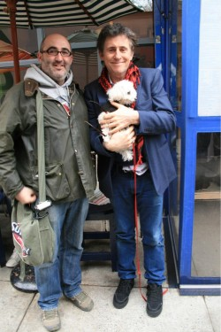 Gabriel Byrne with his dog and a fan.
