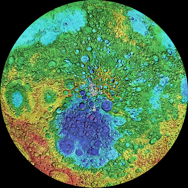 mucholderthen:  Topographical Map of the Moon centering on the south pole Colors represent altitude: purple (over 9,000 metres below surface level),  blue (3,000 below),  green (zero altitude),  yellow (2,000 metres above surface level),  orange (4,000 metres above)  red (8,200 metres above). A massive impact crater known as South Pole - Aitken basin is seen here as the purple and dark blue patch just below the south pole and is 2,500 kilometers in diameter. Picture: SPL / Barcroft Media (via X )  You can't begin to appreciate the violent history of the moon until you see it like this.