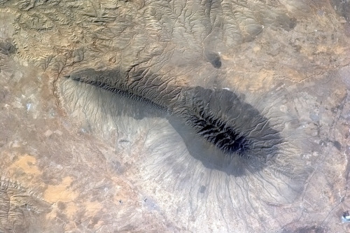 From space, a mighty mountain ridge turns into a tadpole.