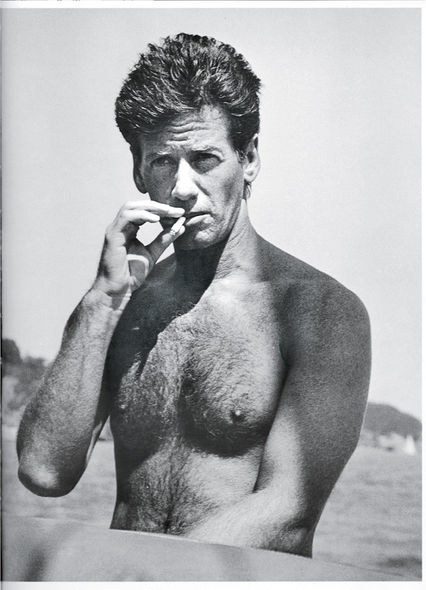 Calvin Klein smokes on the beach. See more from the W travel archive here.
