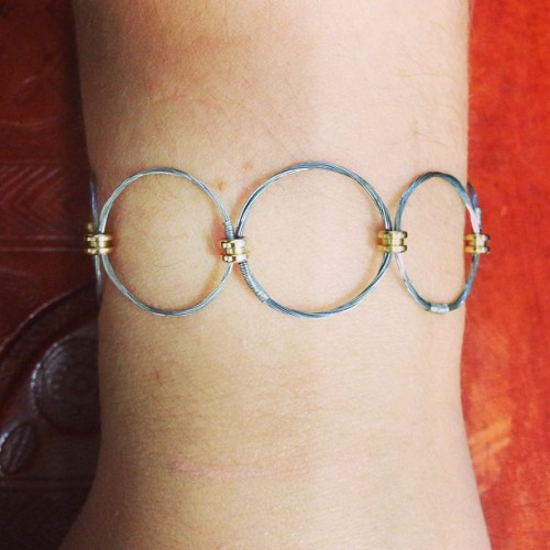modernaquarian:  bracelet made from recycled guitar strings and hoops