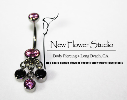 Beautiful dangles for beautiful navels.  Pink and black to match her bikini.  This is how we do it in Long Beach.