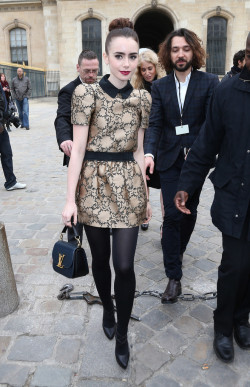 cigarettesandrippedtights:  fashionfever:Lily Collins @ Louis Vuitton F/W 2013