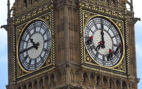 PICTURE OF THEDAY  Workmen clean the clock face on the Elizabeth Tower at the Palace of WestminsterPicture: Julian Simmonds/The Telegraph
