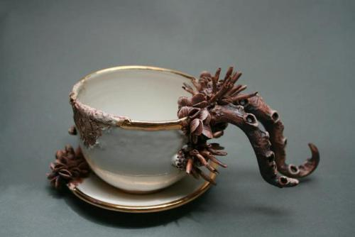 laughingsquid:  Bottom Feeders, Ceramic Cups and Pitchers Covered in Barnacles, Tentacles, and Other Sea Life  I saw her stuff last weekend at the American Craft Council Fair and it was amazing.