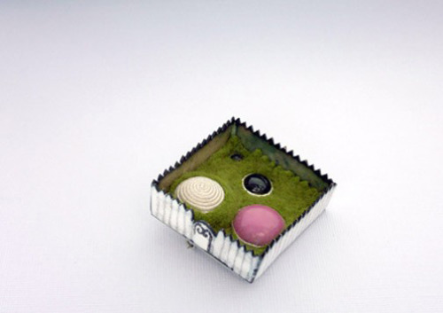 vanessaneily:  my little garden brooch, 2007 sterling silver, copper, enamel, black onyx, recycled button and earring, felt  One of my favourite pieces