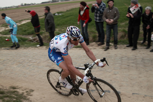 Matthieu Ladagnous | Paris-Roubaix 2012 on Flickr.Via Flickr: Paris–Roubaix is a one-day professional bicycle road race in northern France near the Belgian frontier. From its beginning in 1896 until 1967 it started in Paris and ended in Roubaix (hence the name); since 1968 the start city has been Compiègne (about 60 kilometres (37 mi) north-east from Paris center) whilst the finish is still in Roubaix. Famous for rough terrain and cobblestones (setts),[n 1] it is one of the 'Monuments' or Classics of the European calendar, and contributes points towards the UCI World Ranking. It has been called the Hell of the North, a Sunday in Hell (also the title of a film about the 1976 edition of the race), the Queen of the Classics or la Pascale: the Easter race.[1] The race is organised by the media group Amaury Sport Organisation annually in mid-April. First run in 1896, Paris–Roubaix is one of cycling's oldest races. It is well known for the many 'cobbled sectors' over which it runs, being considered, along with the Ronde van Vlaanderen and Gent–Wevelgem to be one of the cobbled classics. Since 1977, the winner of Paris–Roubaix has received a sett (cobble stone) as part of his prize.[2] In recent years, the terrain over which Paris–Roubaix runs has led to specialized bikes, with unique frames and wheels, being used. Wheel punctures and other mechanical problems are extremely common because of this terrain, and often play a part in who is able to ultimately make it to Roubaix with momentum. Despite the high esteem with which the race is seen, some notable cyclists throughout history have regarded the race as a joke because of its difficult conditions. The race has also seen several controversies over the years, with many seeming winners of the race disqualified for various reasons. The course is maintained by Les Amis de Paris–Roubaix, a group of fans of the race formed in 1983. The forçats du pavé seek to keep the course as safe as possible for riders while maintaining its difficulty.