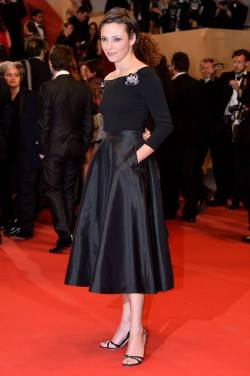 Jasmine Trinca looked lovely at the Cannes premiere of Miele by Valeria Golino on May 17th, 2013. She wore a Miu Miu outfit - boatneck top with diamanté appliques, satin full skirt and strappy sandals.
