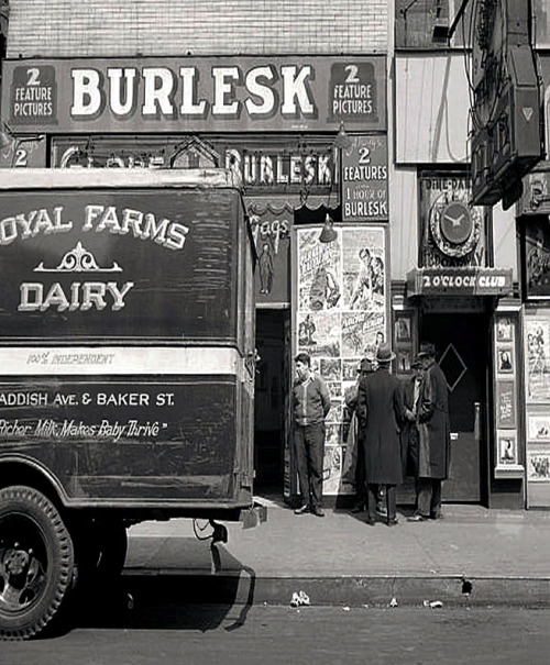 A vintage photograph features both the 'GLOBE Burlesk' theatre and the famed '2 O'Clock Club' in Baltimore, Maryland.. As photographed by Marjory Collins, in 1943.. I'm pretty certain the barker seen (at Left) in this photo is also this guy..