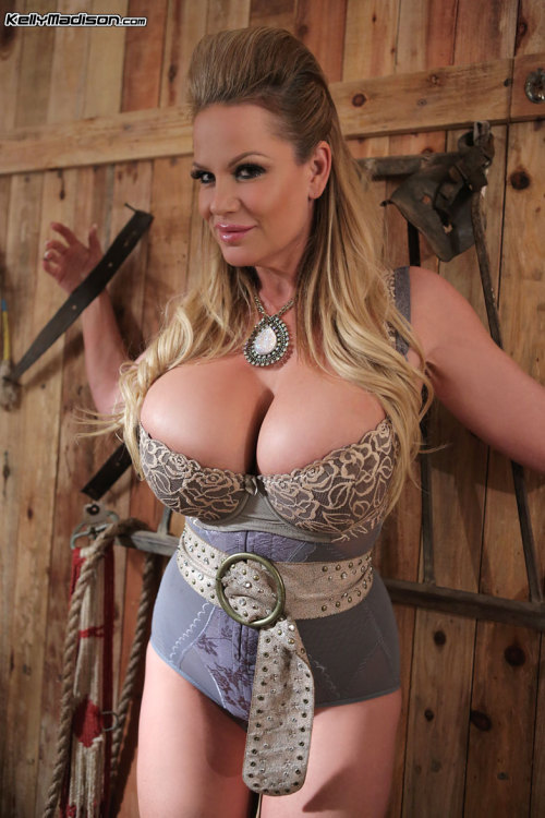 Huge tits mature sexbomb, Kelly Madison, loves putting them out there for men to enjoy.. #TittyTuesday BOOB ON!