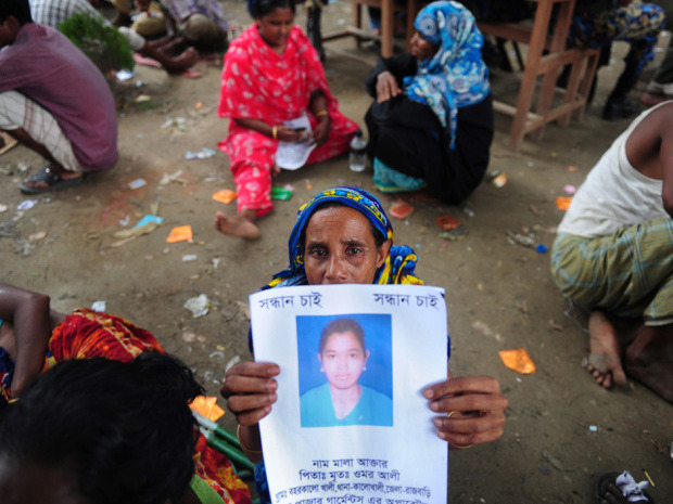 "Shoppers turn blind eye to Bangladesh tragedies as cheap clothes winIn the wake of disasters in Bangladesh garment factories that have claimed hundreds of lives in recent months, shoppers in the West have shown growing concern about worker safety in developing countries. As long as it doesn't mean an end to bargains.""It bothers me, but a lot of retailers are getting their clothes from these places and I can't see how I can change anything,"" 21-year-old university student Elizabeth McNail said, clutching a brown paper bag from clothier Primark the day after a building collapse in Savar, Bangladesh, killed at least 381 people. ""They definitely need to improve, but I'll still shop here. It's so cheap."" (Munir Uz Zaman/AFP/Getty Images)"