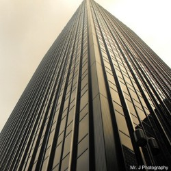 When I was in #NYC last time using the old #Fujifilm #S1000fd #skyscraper #buildings #reflection #lighting #composition #downtown #morningshot (at 4233 42nd Street)