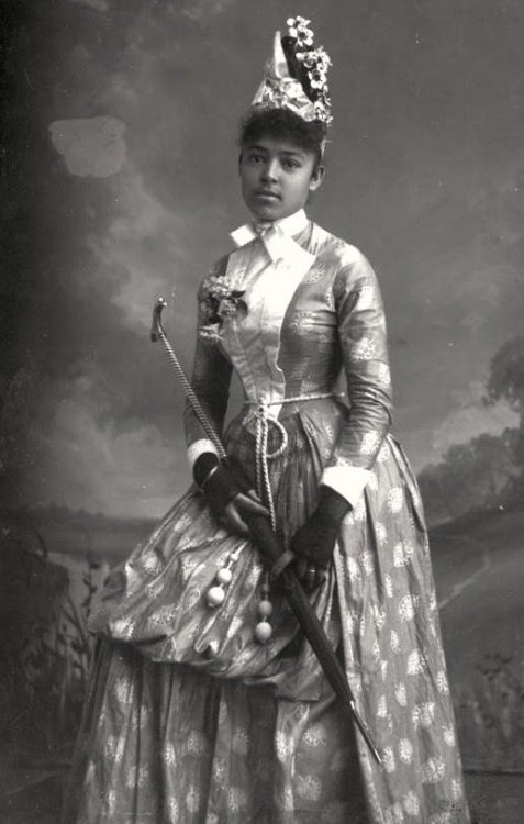 LADY NELLIE | BLACK VICTORIANS | 1895 Nellie Franklin decked out in Victorian splendor holding a parasol. Tallahassee, Florida circa 1885-1911. Alvan S. Harper Collection, State Library and Archives of Florida. Black History Album, The Way We WereFollow us on TUMBLR  PINTEREST  FACEBOOK  TWITTER