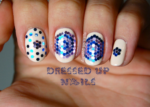 dressedupnails:  Loose glitter patterns for day 3 of bling week, on a base of Lime Crime Milky Ways because I literally cannot get enough of off-white polishes SORRY I'M NOT SORRY. More at the full post!