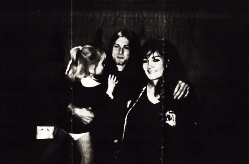 Kurt Cobain with his girlfriend at the time, Tracy Marander and his half-sister Brieann. Christmas, 1988.