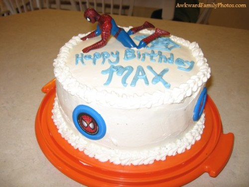 """I was really proud of this Spiderman cake I made for my sons 4th birthday. I tried to get both Spiderman and the motorcycle he was riding on the top of the cake. Unfortunately, both didn't fit. I didn't realize until the party was in full swing what exactly Spiderman was doing to the cake."""