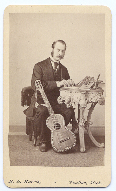 ca. 1860-1890's, [carte de visite portrait of a musician hard at work with his beautiful mother-of-pearl inlay guitar] via Capitol Gallery, Cabinet Card & Carte de Visite Catalogue