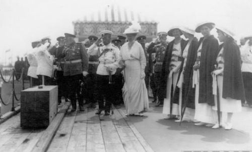 The Emperor and Empress greeting a group of officers with their daughters: 1915.