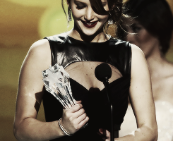 Jennifer Lawrence holding her award statues of 2013 in chronological order: People's Choice Award for Favorite Actress; Critics' Choice Award for Best Actress in a Comedy; Golden Globe Award for Best Performance by an Actress in a Motion Picture - Musical or Comedy; SAG Award for Outstanding Performance by an Actress in a Leading Role; SBIFF Outstanding Performance of the Year Award; Oscar Award for Best Actress