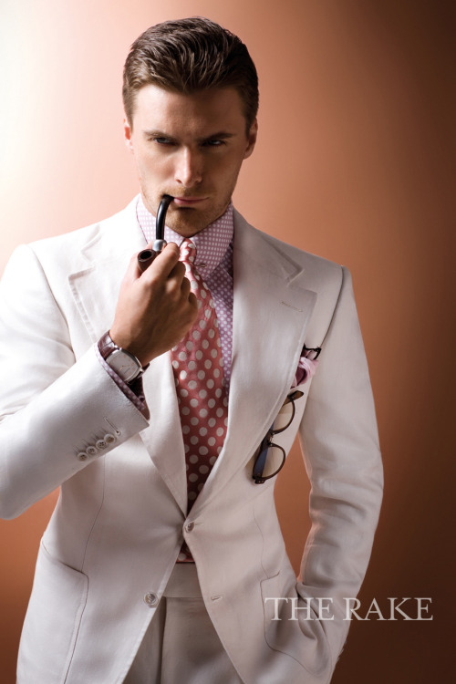 rakehound:  White single-breasted linen twill two-piece suit, pink and white polka-dot cotton shirt, pink and white polka-dot silk tie, gold-plated collar bar and pink and brown print silk pocket square, all Tom Ford; dark brown tortoiseshell acetate sunglasses, Giorgio Armani; Tradition Extra-Thin timepiece in platinum case and brown crocodile strap, Audemars Piguet.