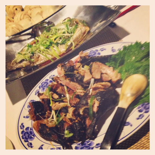 Tea smoked duck & steamed barramundi cooked for friends.  Tea smoked duck is not a dish you see often. It is claimed to have originated in central China, though you will find it listed in the cuisine of many regions. It takes up to three days to prepare if marinated to full effect, so is best left to a special occasion.  After slow marinating in a rub of Chinese sorghum  spirit, ginger and spices you air dry the duck, then blanch it to tighten the skin. This also renders some of the fat. Then you air dry it again before smoking over tea leaves, rice, sugar and cassia bark to assist the smoky flavour to penetrate the skin.  I reduced the blanching water to a concentrate, and poured the resting juices from smoking into it to make a broth. The juices are flavoured with star anise, cassia, mandarine peel and spring onion stuffed in the duck cavity. I served this at the start of the meal.  Next stage is steaming the duck. I added lemon to my steaming water to draw some of the more intense smokiness off the skin.  Just before serving I rubbed the duck with potato starch and deep fried it to crisp the skin. The meat was moist and tasty. Well worth the effort.  The barramundi was steamed and seasoned in the traditional manner, with the hot oil added from the deep fryer to sear the skin, ginger and spring onion topping.  In the background are Mantou (Bao - steamed bread) which curiously were said to have been invented by Zhuge Liang - known as Crouching Dragon - a famous Chinese strategist and inventor who live in the 1st century AD, the Three Kingdoms period. Mantou were said to be the heads of the enemy war lords and soldiers battling in a war to unify China under their command.  I have a porcelain statue of Zhuge Liang in my home. I knew nothing of him when I spotted the statue in a dark and dusty shop in the world heritage listed part of Hoi An in Vietnam. When I brought him home my father was amazed, he told me I had purchased a fellow strategist who loved to cook - serendipitous!