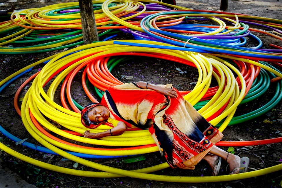 Photo of the Day: A woman rests on Internet cables awaiting installation at Dhaka University in Bangladesh Photo by GMB Akash (Narayanganj, Bangladesh); Dhaka, Bangladesh