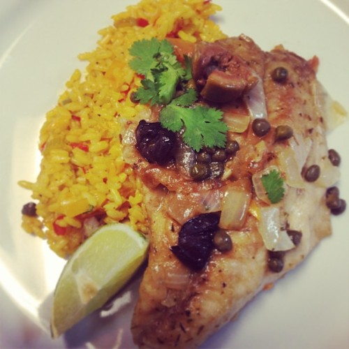 Red snapper cooked in cappers and olive sauce over Mexican rice. #food #mexico #fish (at Auguste Escoffier School Of Culinary Arts)