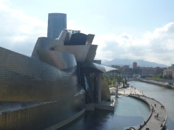 "Bilbao, Spain is a transformed city with lots of cool architecture and outdoor art. Don't miss the famous Guggenheim Museum designed by Frank Gehry, considered by some to be ""the greatest building of our time.""  There's so much to say about the Guggenheim, you can spend ages and ages just looking at the exterior of the building. It is so gigantic and it's shape so eccentric that we spent quite a while just walking around the building and seeing it from all viewpoints. I've heard that the design of the building is influenced from the curving shapes you can see in flowers and ships. I can definitely see the link with boats: there are many curvy walls that reach together in a sharp point like the bow of a ship. The fact that Bilbao is a big fishing port ties the building in nicely with the city's industry. Read more"
