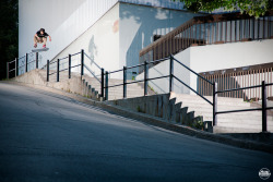 Sean Malto switch frontside flip over the rail and into the bank in Montreal. Photo by Aaron Smith