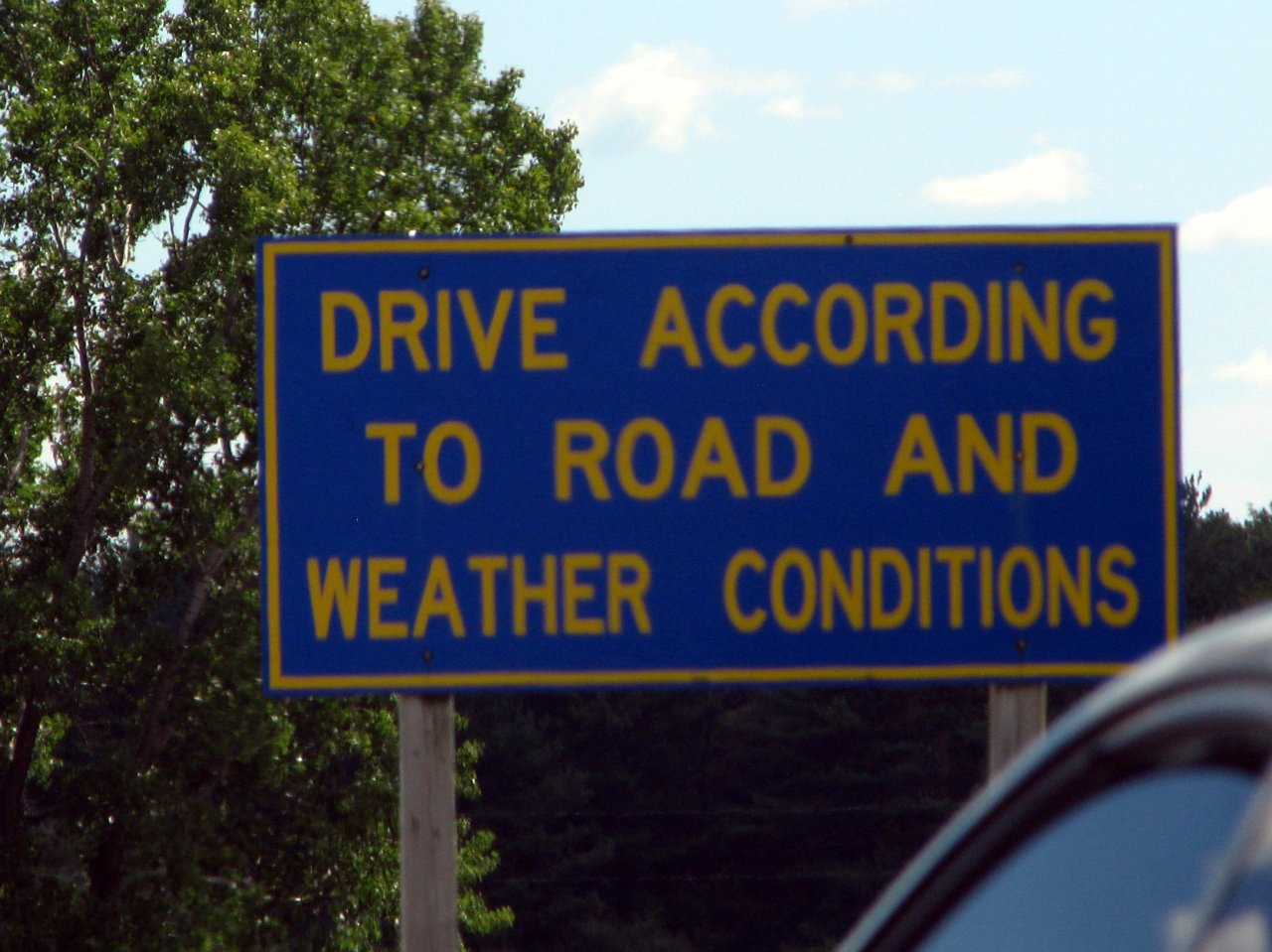 "This sign is a tacit admission that the people behind the wheel don't ""drive according to road and weather conditions"""