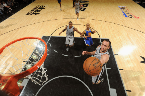 nba:  Manu Ginobili of the San Antonio Spurs goes up for the layup against the Golden State Warriors in Game Two of the Western Conference Semifinals during the 2013 NBA Playoffs on May 8, 2013 at the AT&T Center in San Antonio, Texas. (Photo by Andrew D. Bernstein/NBAE via Getty Images)