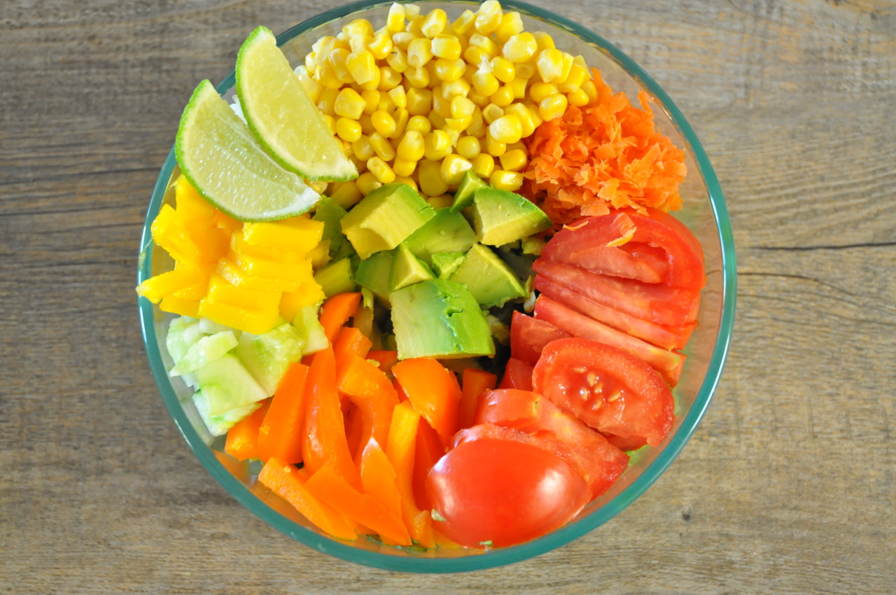 capitalveg:  raw western salad- under all these beautiful toppings is a head of romaine. bell pepper mango organic corn grated carrots tomato cucumber avocado and lime!