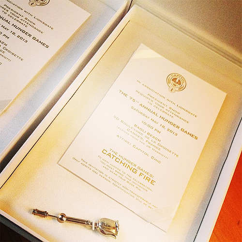 catchingupdates:  Catching Fire party invitations for Cannes 2013  In association with Lionsgate. President Snow requires your attendance to celebrate The 75th Annual Hunger Games.  Saturday, May 18th 2013 10:00PM. (photo credit)