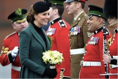 "Kate Middleton dressed in green for the St. Patrick's Day parade where she addressed troops of the 1st Battalion Irish Guards. Kate made small talk with one of the guards saying: ""I'd like to have a boy and William would like a girl""."