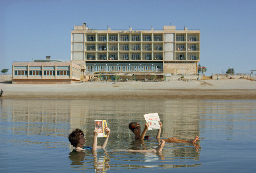 natgeofound:  Bathers read magazines near shoreline while floating in the Dead Sea, December 1964.Photograph by Luis Marden, National Geographic