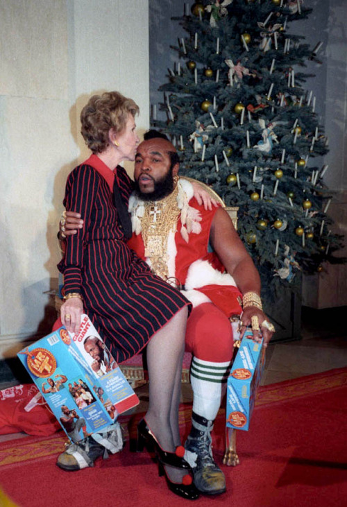 historicporn:  Nancy Reagan sits on the lap of Mr.T during Christmas.1983.