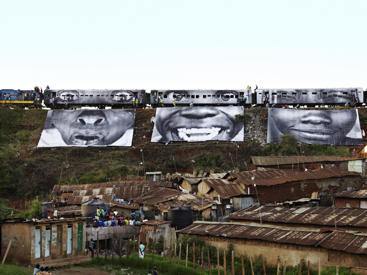 Artwork of the day: 28 Millimetres, Women are Heros - In Kibera Slum, train passage 1, 2010 by JR