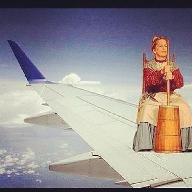 THERE'S A WOMAN IN TRADITIONAL COLONIAL GARB ON THE WING OF THE PLANE! #theressomethingtheyrenottellingus #bridesmaids #funny