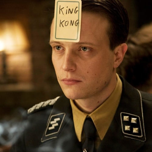 "momentsforeverfaded:  beautilation:  This scene in Inglourious Bastards, this particular part, was so brilliantly written. The characters are playing a game where you sit in a circle and write a famous person's name on a card, flip it over, pass the card to the person next to you and stick it to your head without looking. Then you ask everyone questions to figure out who it is. This man- a Nazi commander- asked ""Am I American?"" (no but..) ""Have I visited America?"" (yes) ""Was my visit fruitious?"" (no) ""Did I go against my will?"" (yes) ""Am I from a place you'd call exotic?"" (yes) ""Am I from the jungle?"" (yes) ""Did I go by boat?"" (yes) ""And when I got there was I bound with chains and presented in front of a crowd?"" (yes!) ""Well then. I know who I am. An African slave. No? Oh then I'm King Kong."" — and in one instance the viewer realizes the metaphor which King Kong was to the African slave trade (a truly Tarantino way of inserting social awareness through dialogue spoken by social oppressors) as well as takes a moment of almost comic relief to a very strange middle ground since we see just how intelligent and foolproof this man is. This is good filmmaking.   I did not know this."